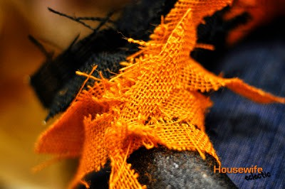Tie orange burlap on a wreath form for a Burlap Halloween Wreath