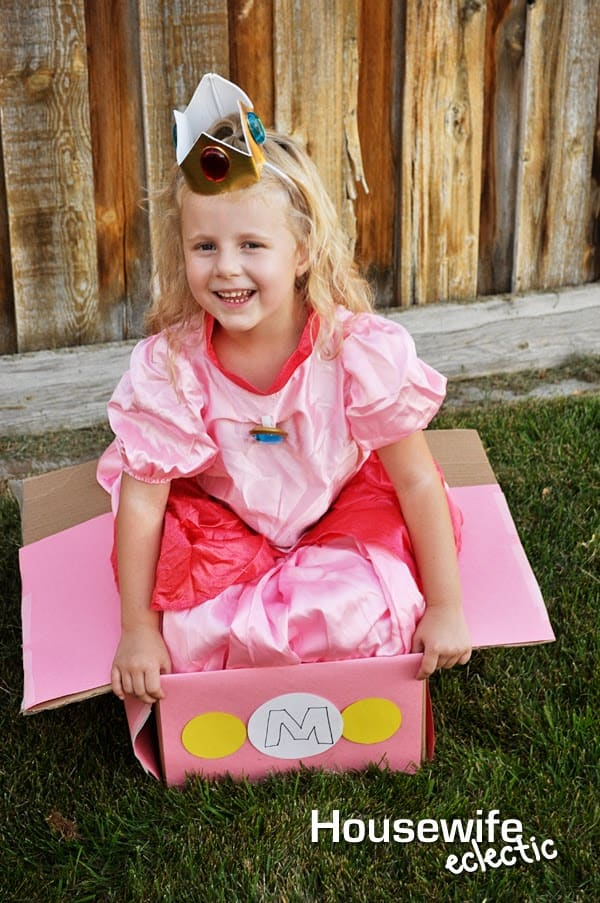 Cut the bottom flaps and front top flap off your car. This is will give your child a place for their legs to go. I leave the top flaps besides the front ...  sc 1 st  Housewife Eclectic & Princess Peach Mario Kart Costume - Housewife Eclectic