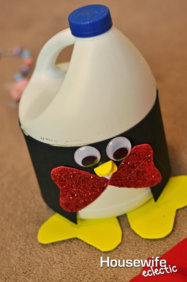 Hot Glue The Yellow Hearts Onto The Bottoms Of The Bottle To Be The Feet Of  Your Penguin.
