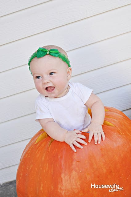 Baby in a pumpkin photo to remember Baby's First Halloween