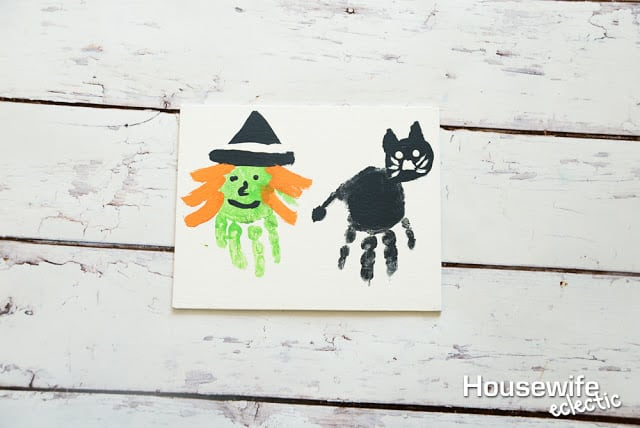 Witch and Cat Handprints to remember Baby's First Halloween