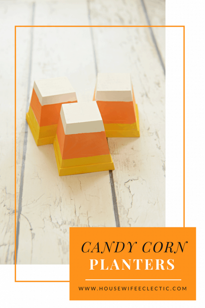 This darling Candy Corn Decor is made from little planters! The perfect Halloween decoration.